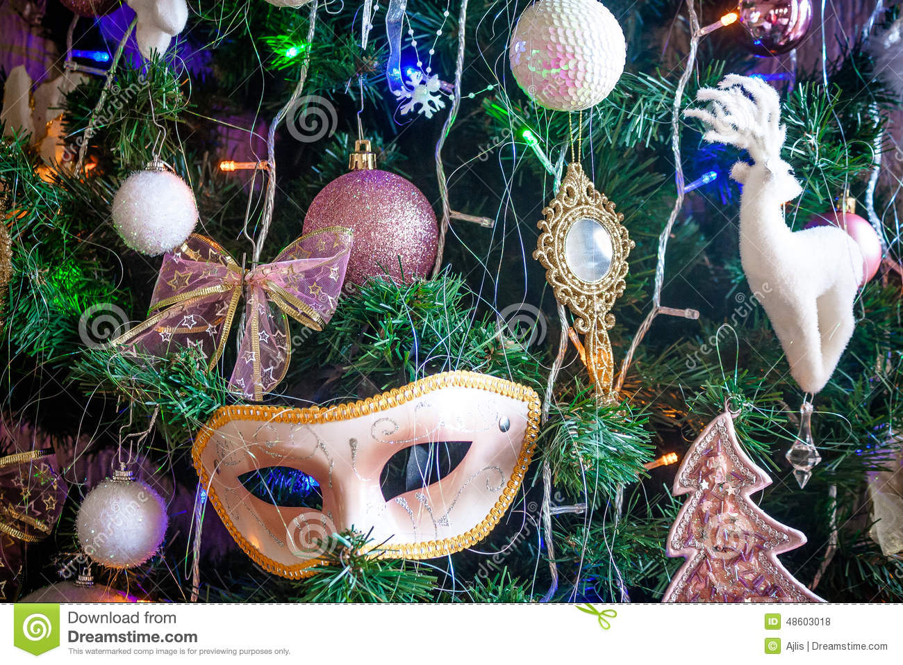 Decoration on a christmas tree in the form of carnival for Decoration carnaval