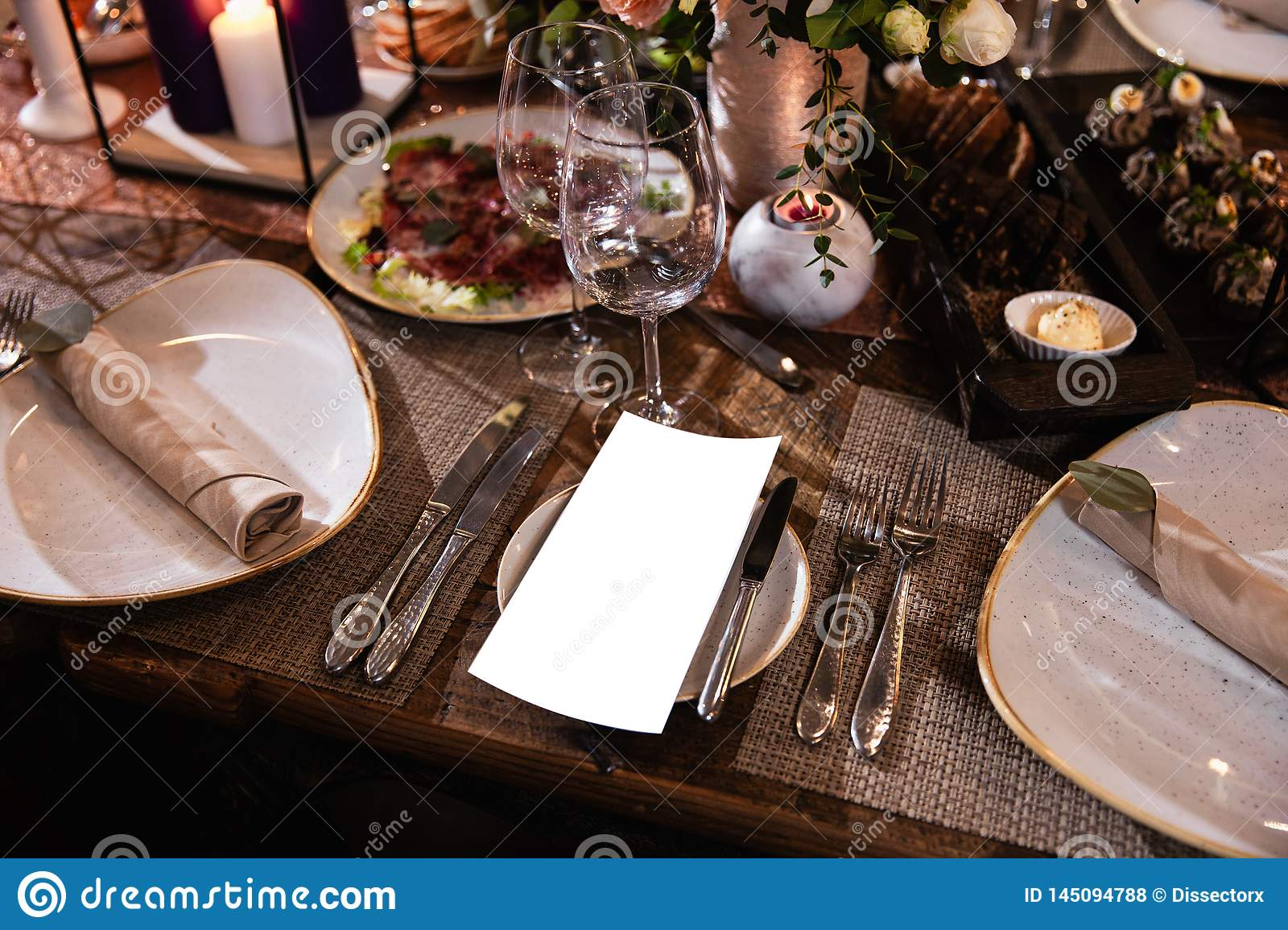 Decoration of a table at a wedding reception or birthday party - Beautiful dark colors