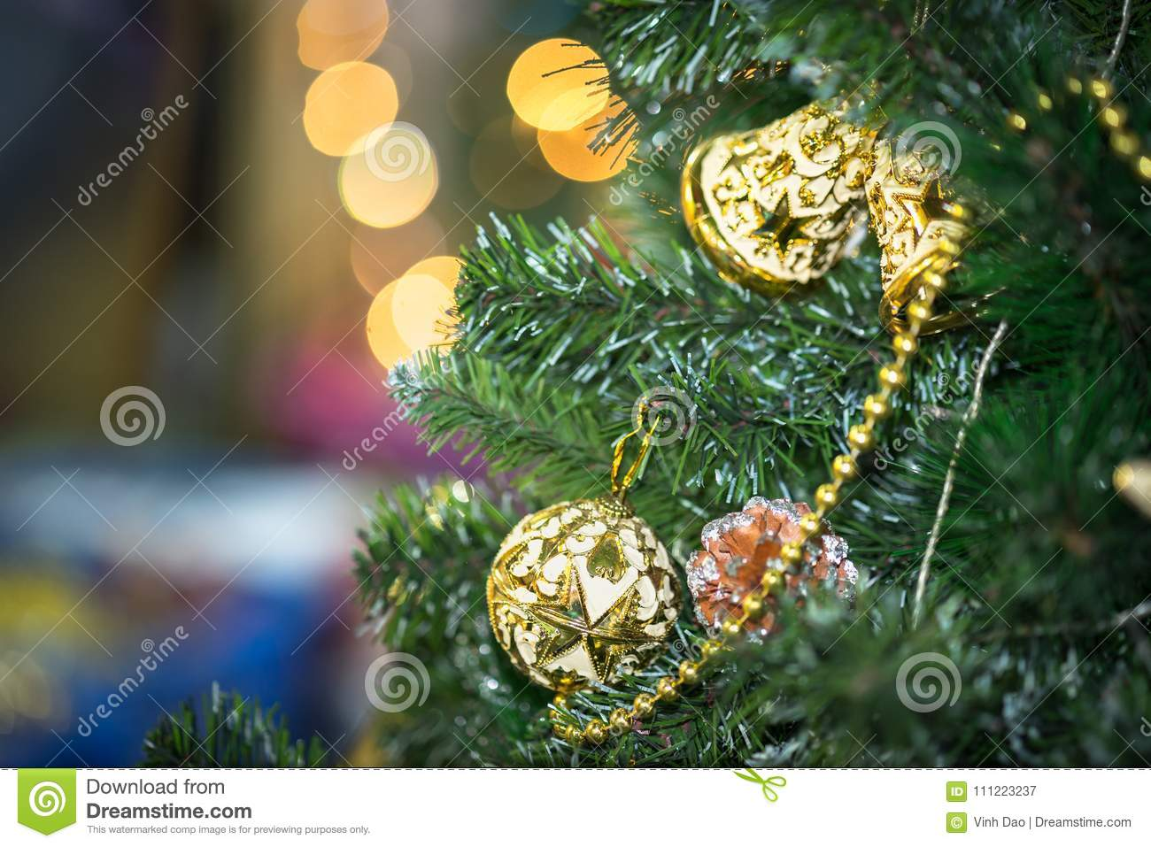 download decorations on christmas tree at night with bokeh on background soft focus stock image - Christmas Tree Hooks Decorative