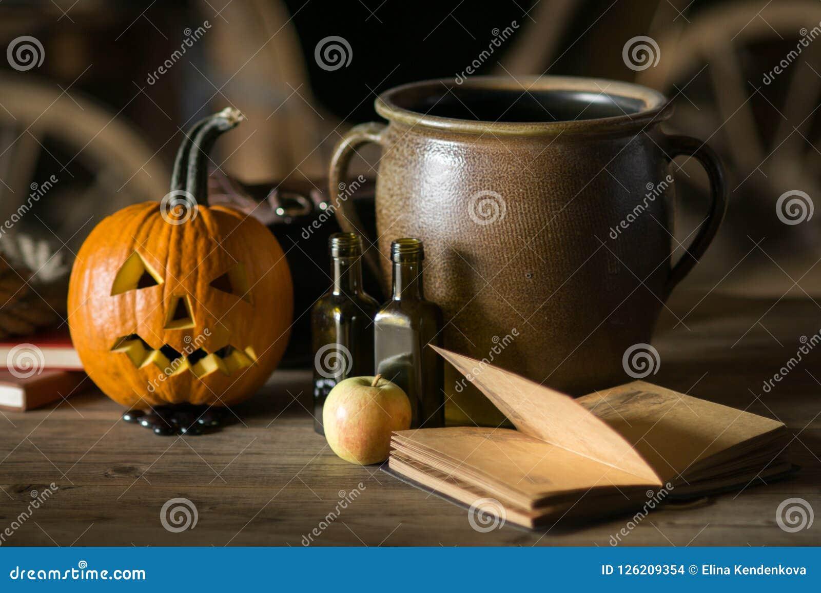 Still life with pumpkin face on halloween in october