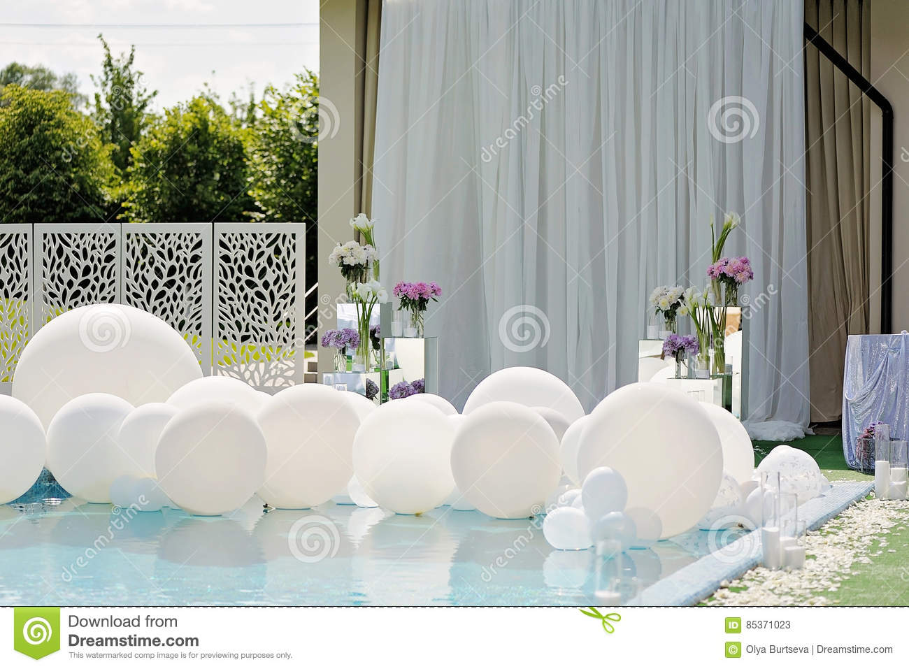 Decorations For The Wedding Ceremony By The Pool With Blue Water