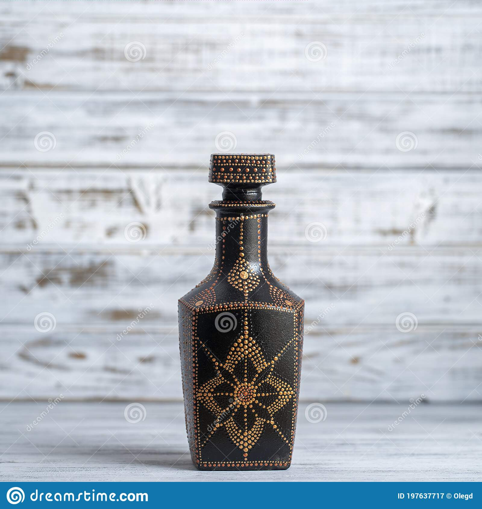 Decorative Ceramic Bottle With Black Red And Golden Colors Painted Bottle On White Wooden Background Dot Painting Stock Image Image Of Antique Background 197637717