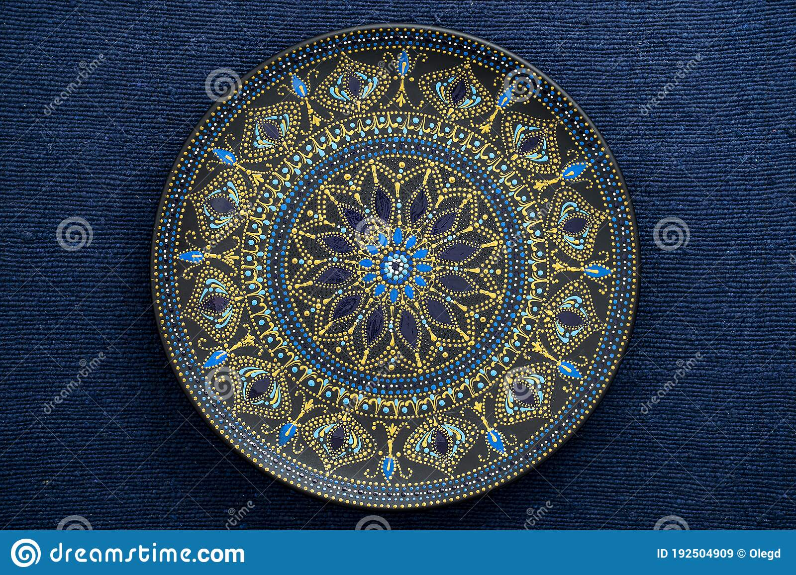 Decorative Ceramic Plate With Black Blue And Golden Colors Painted Plate On Background Of Blue Fabric Dot Painting Stock Image Image Of Mandala Dishware 192504909