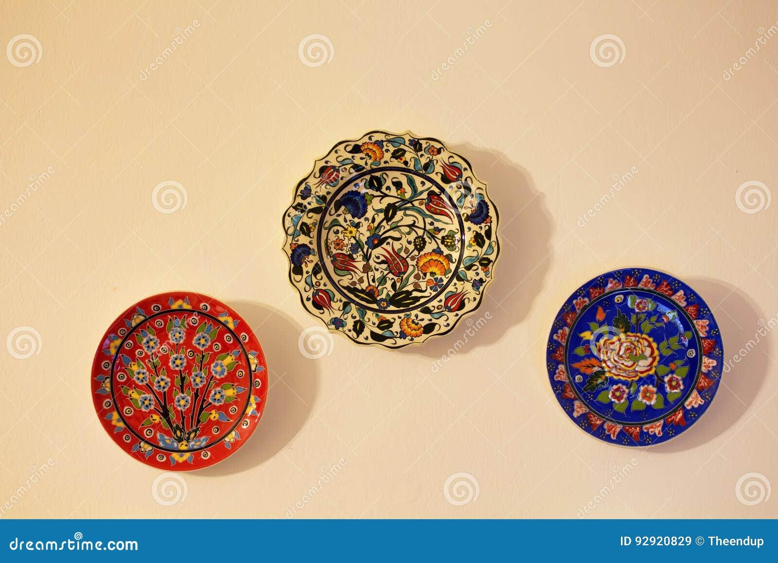 Decorative Ceramic Plates On Beige Wall. Stock Image - Image of ...