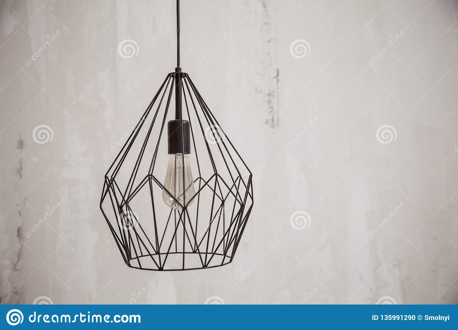 Decorative Chandelier On A White Wall Background Chandelier