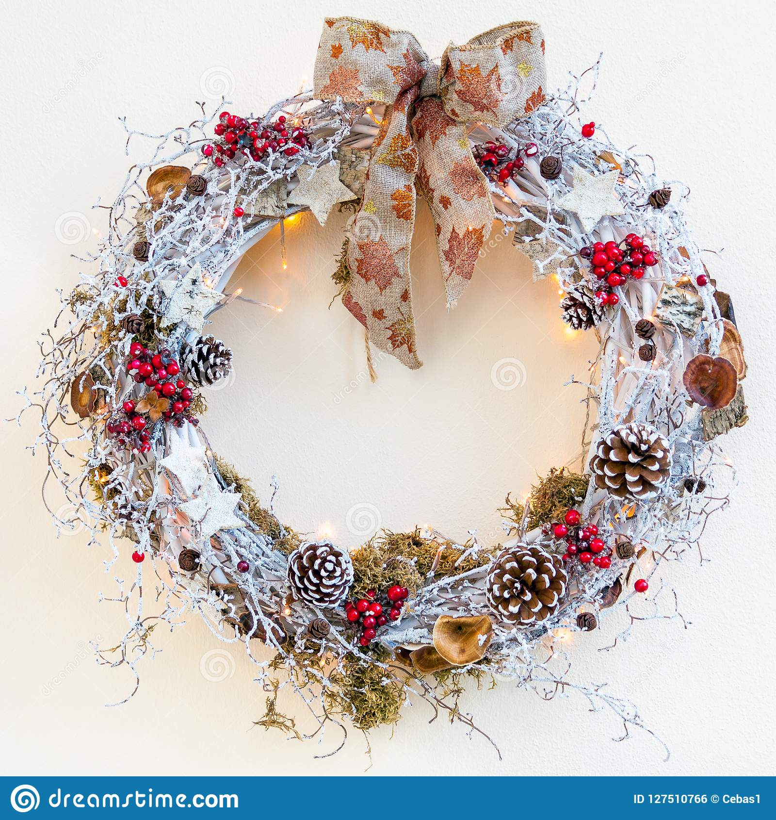 Decorative Christmas wreath picture on neutral background