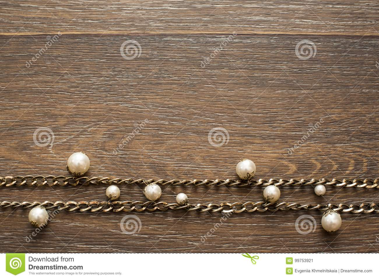 Decorative composition of women`s jewelry on wooden dark background.