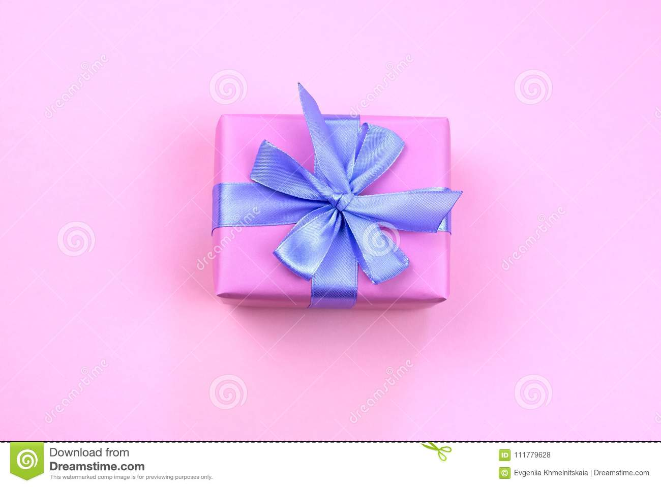 Decorative festive gift box with pink color on pink background.