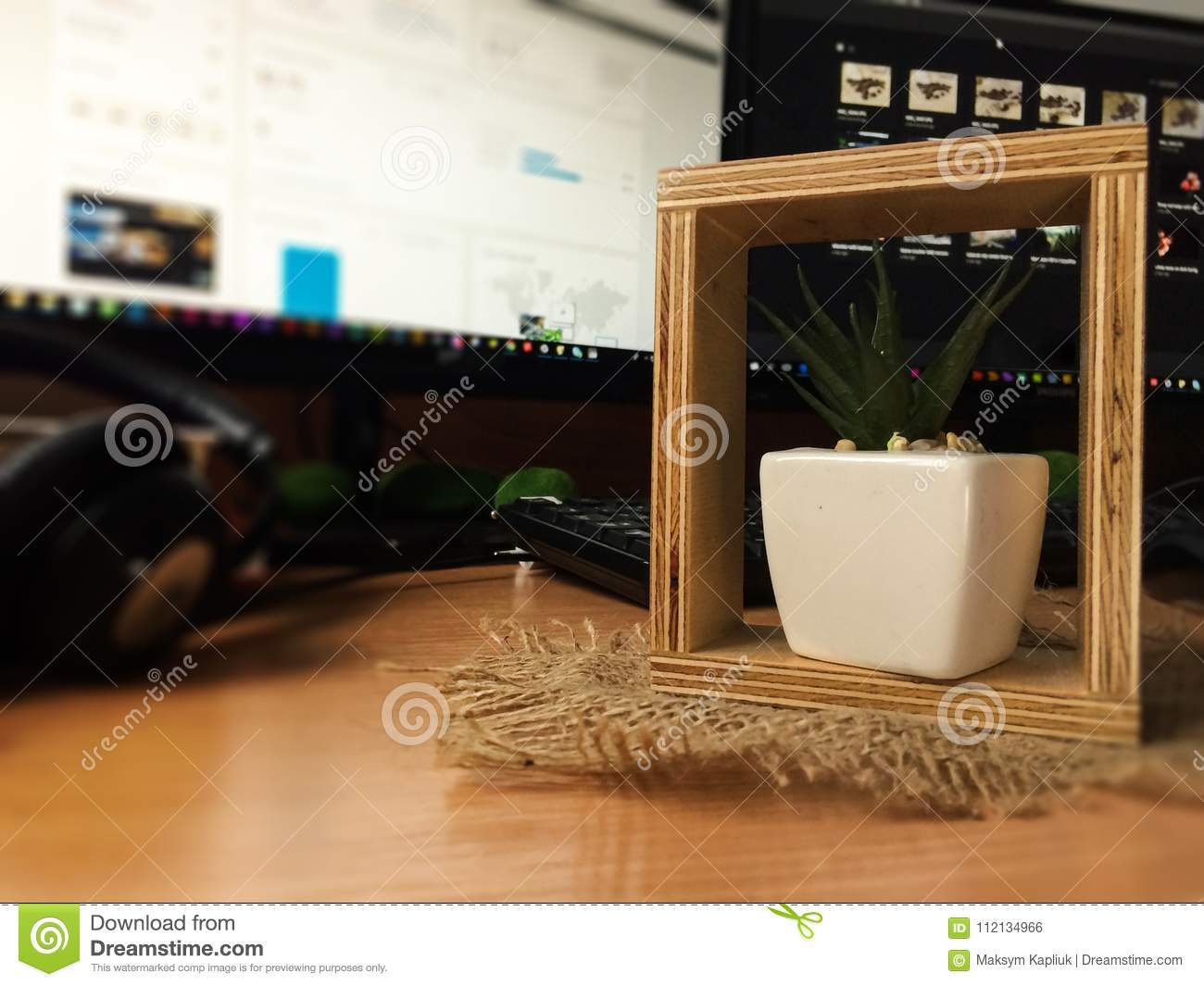 Decorative flower pot on the table with blurred background.