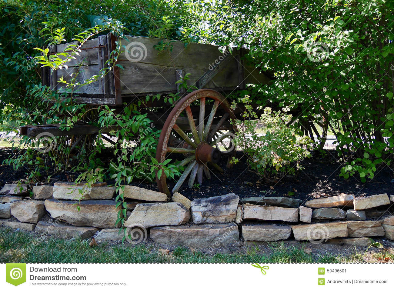 Decorative Garden Cart And Stone Border Stock Photo - Image: 59496501