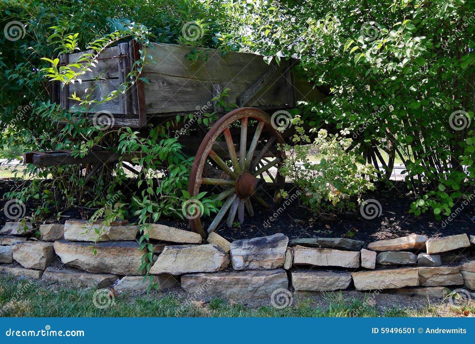 Decorative Garden Cart And Stone Border Stock Image - Image of ...
