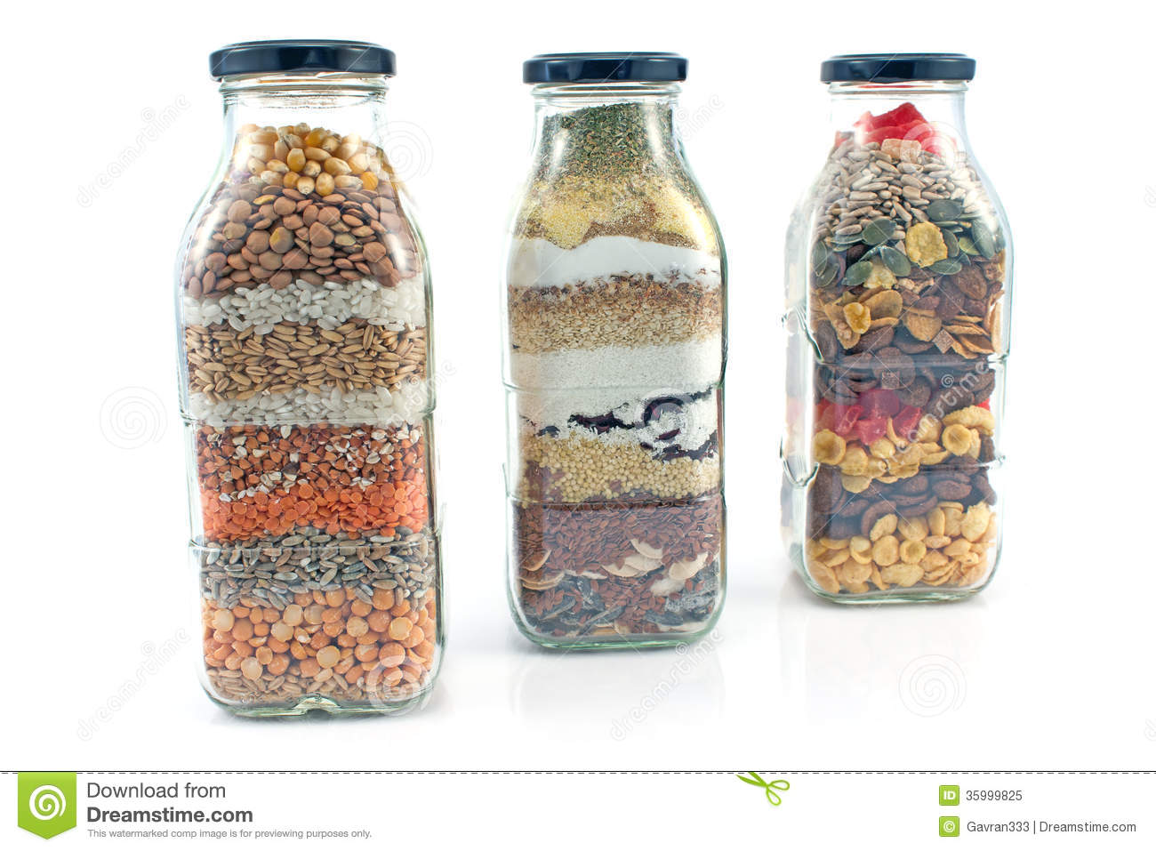 Ornamental bottles - Decorative Glass Bottles With Seeds Royalty Free Stock Photo