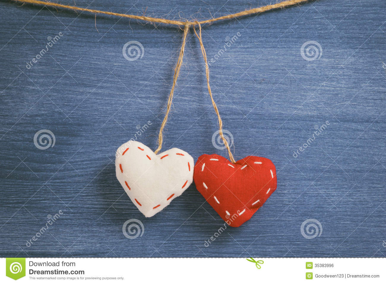 Decorative Wall Hanging Hearts : Decorative hearts hanging on the rope against blue wood