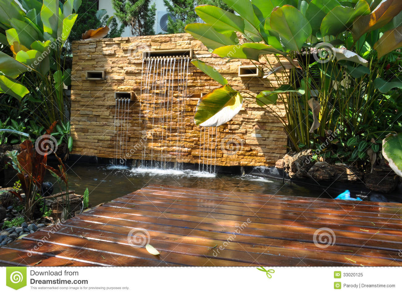 Decorative home garden stone waterfall pond stock image for Cascadas para jardin fotos