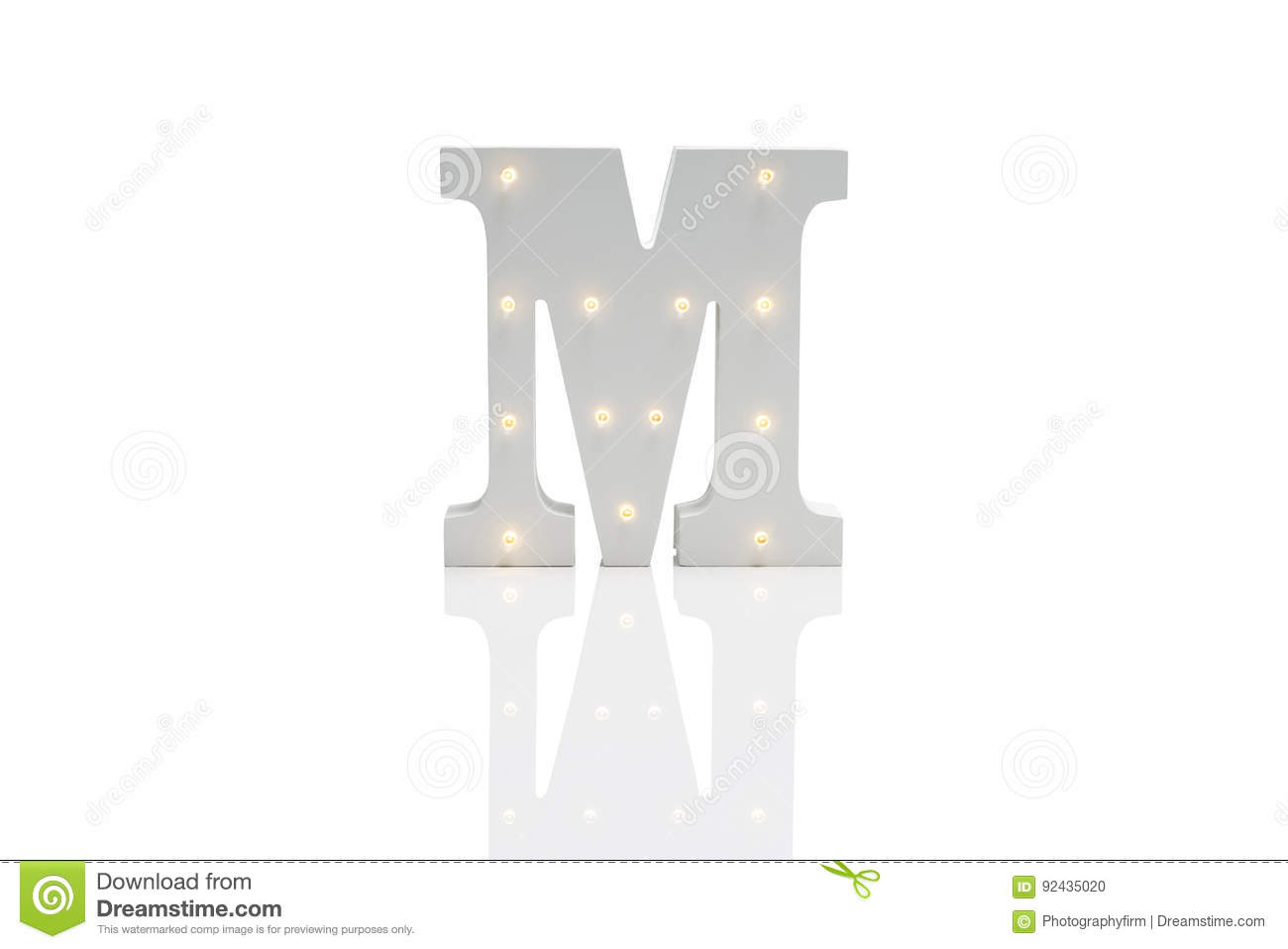decorative letter m with embedded led lights over white backgrou
