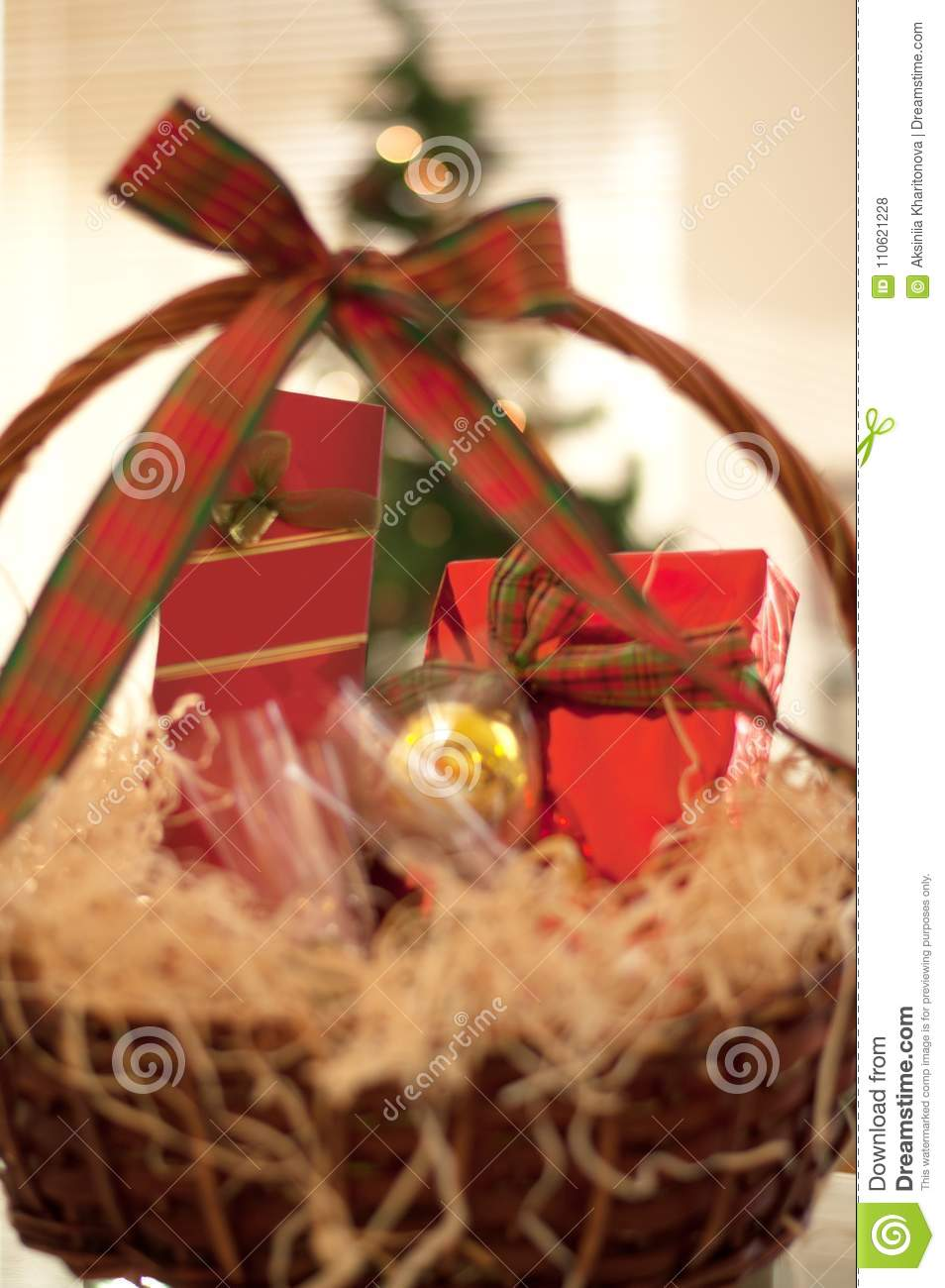 Decorative New Year`s gift baskets with a set of sweets and alco