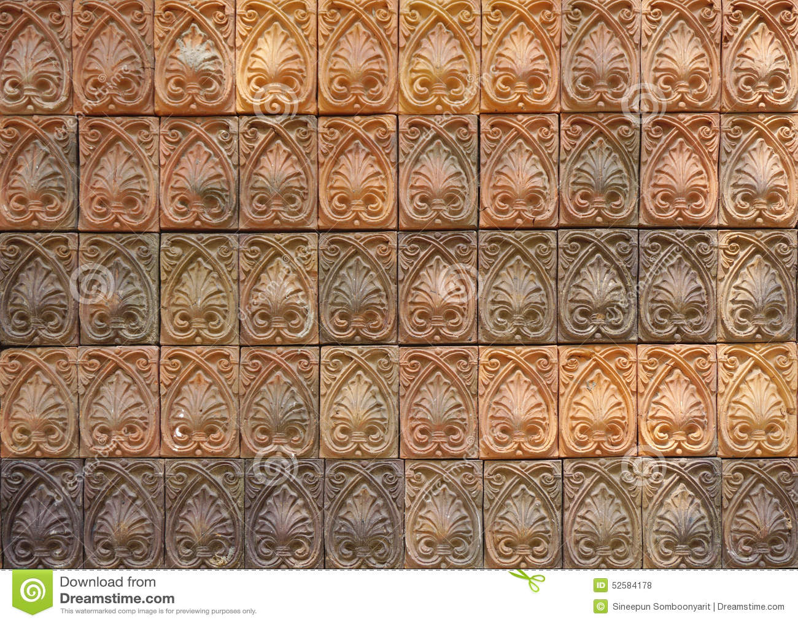 decorative orange tone color terracotta tiles wall stock photo