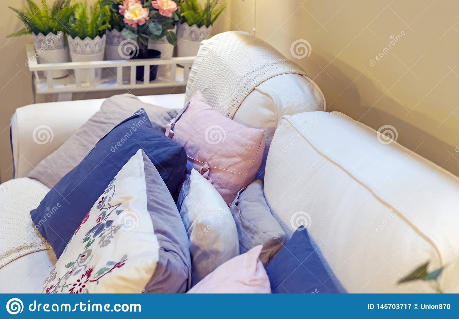 Peachy Decorative Pillows On A White Sofa In The Interior Of A Andrewgaddart Wooden Chair Designs For Living Room Andrewgaddartcom