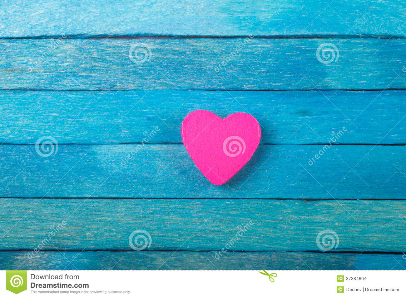 decorative pink heart on blue background stock photo