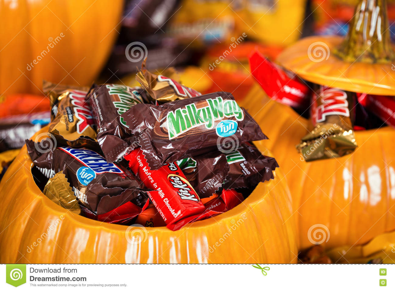 decorative pumpkins filled with assorted halloween chocolate can