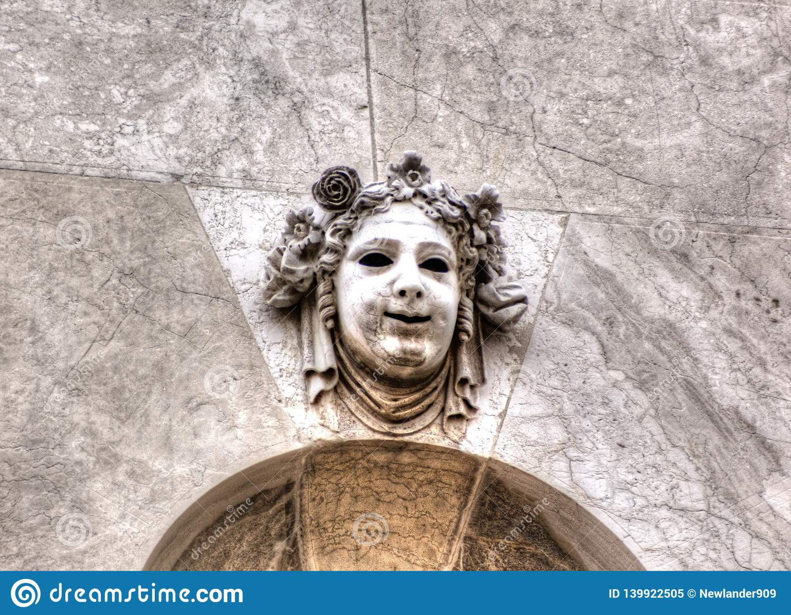 Decorative stone comedy mask. Venice, Italy.