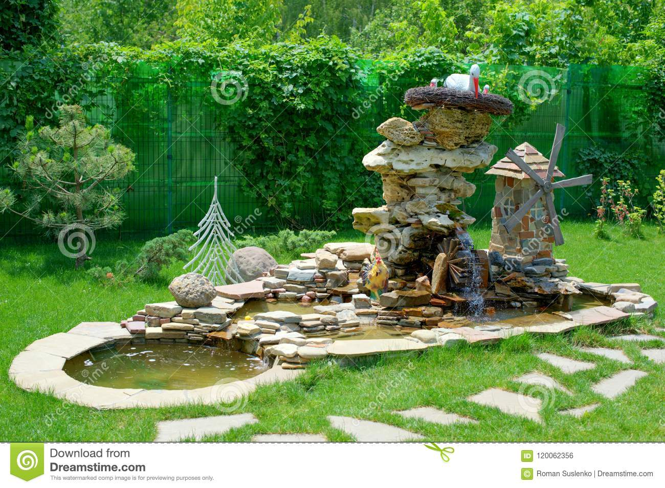 Decorative Stone Fountain With Water Mill And Garden