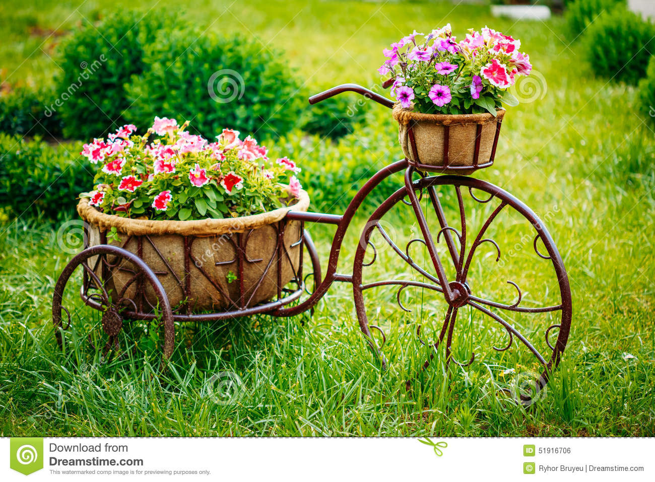 Decorative vintage model old bicycle equipped stock photo for Classic house with flower garden
