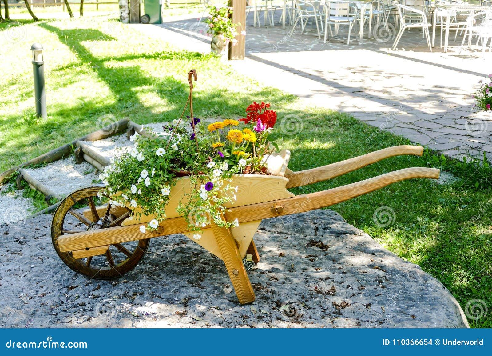 Decorative Wooden Wheelbarrow With Flowers Stock Photo - Image of ...