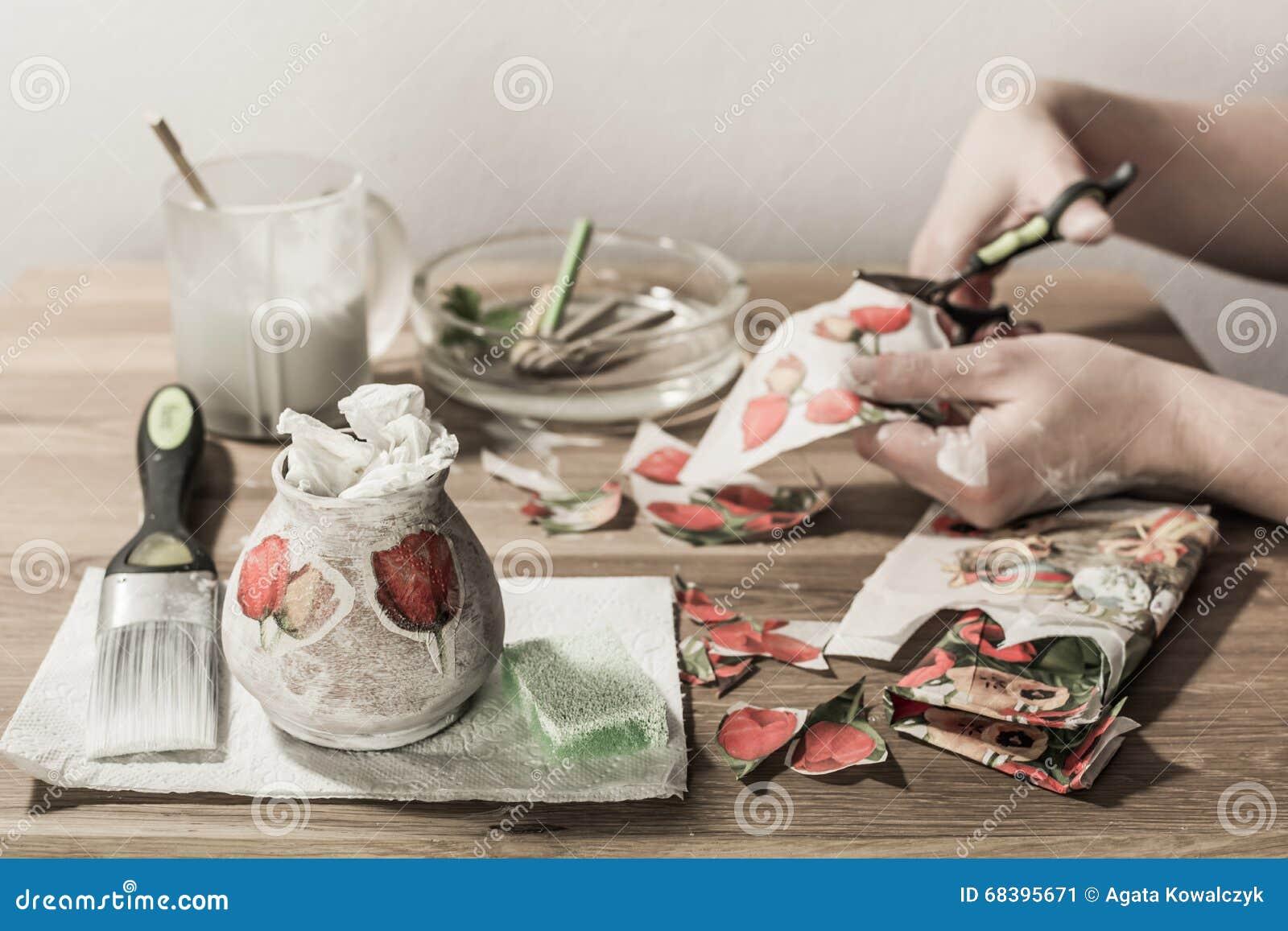 Decoupage hobbyist decorating vase stock image image of glue decoupage hobbyist decorating vase reviewsmspy