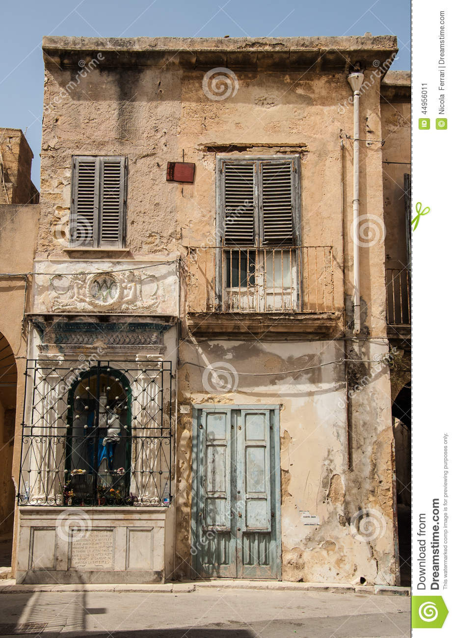 Decrepit Old House With A Small Shrine In The Front Stock Image