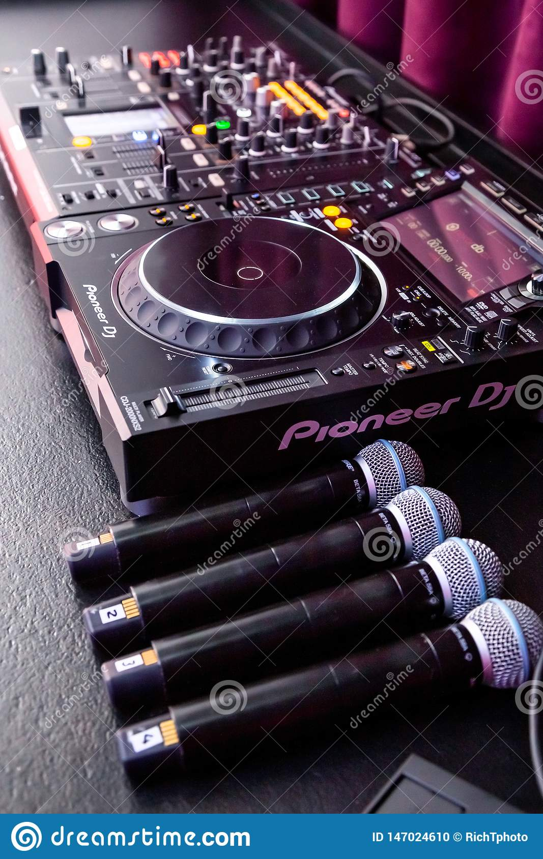 Deejay mixing desk and microphones