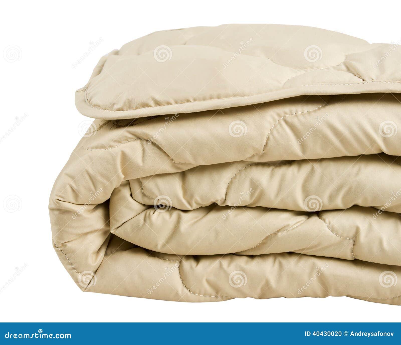 Deel van beige die deken op witte achtergrond wordt een geïsoleerd