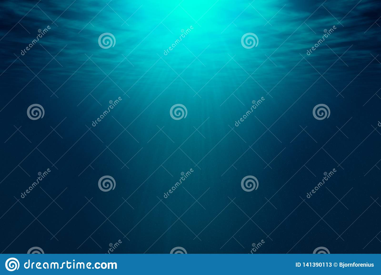 Deep blue sea with rays of sunlight, ocean surface seen from underwater.