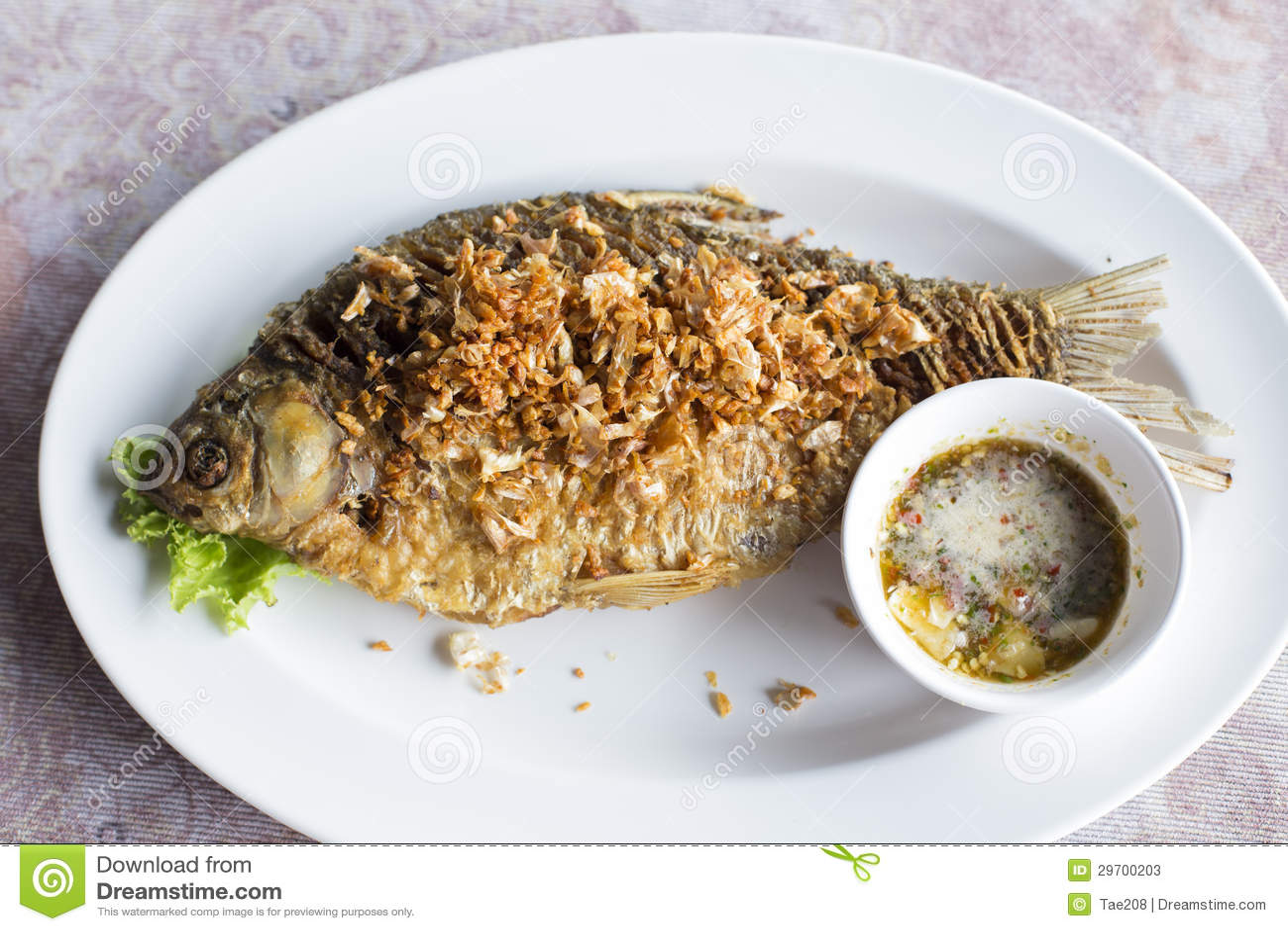 Deep fried java barb fish with garlic stock photos image for Garlic sauce for fish