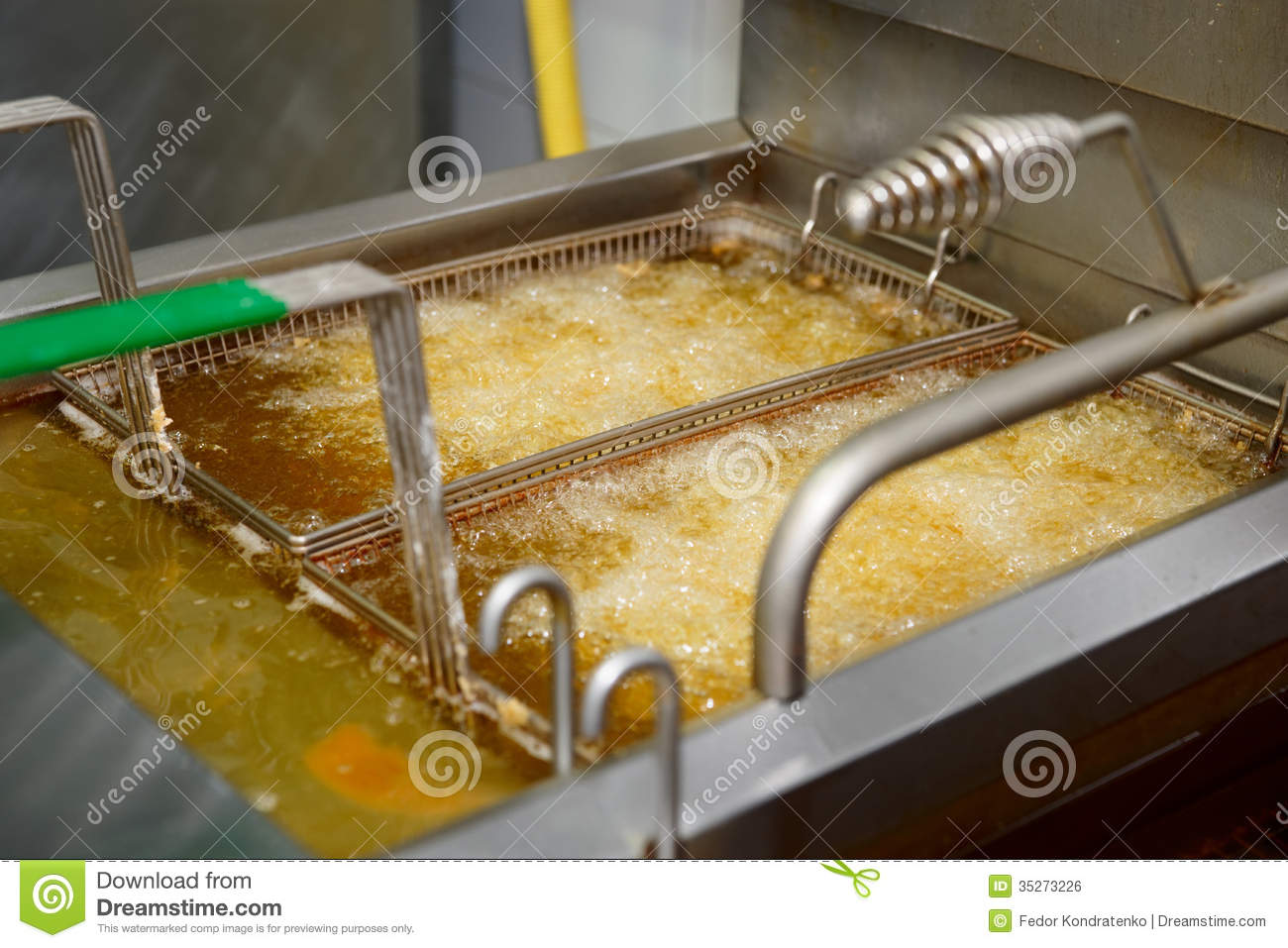 Deep Fryer With Boiling Oil Royalty Free Stock Image