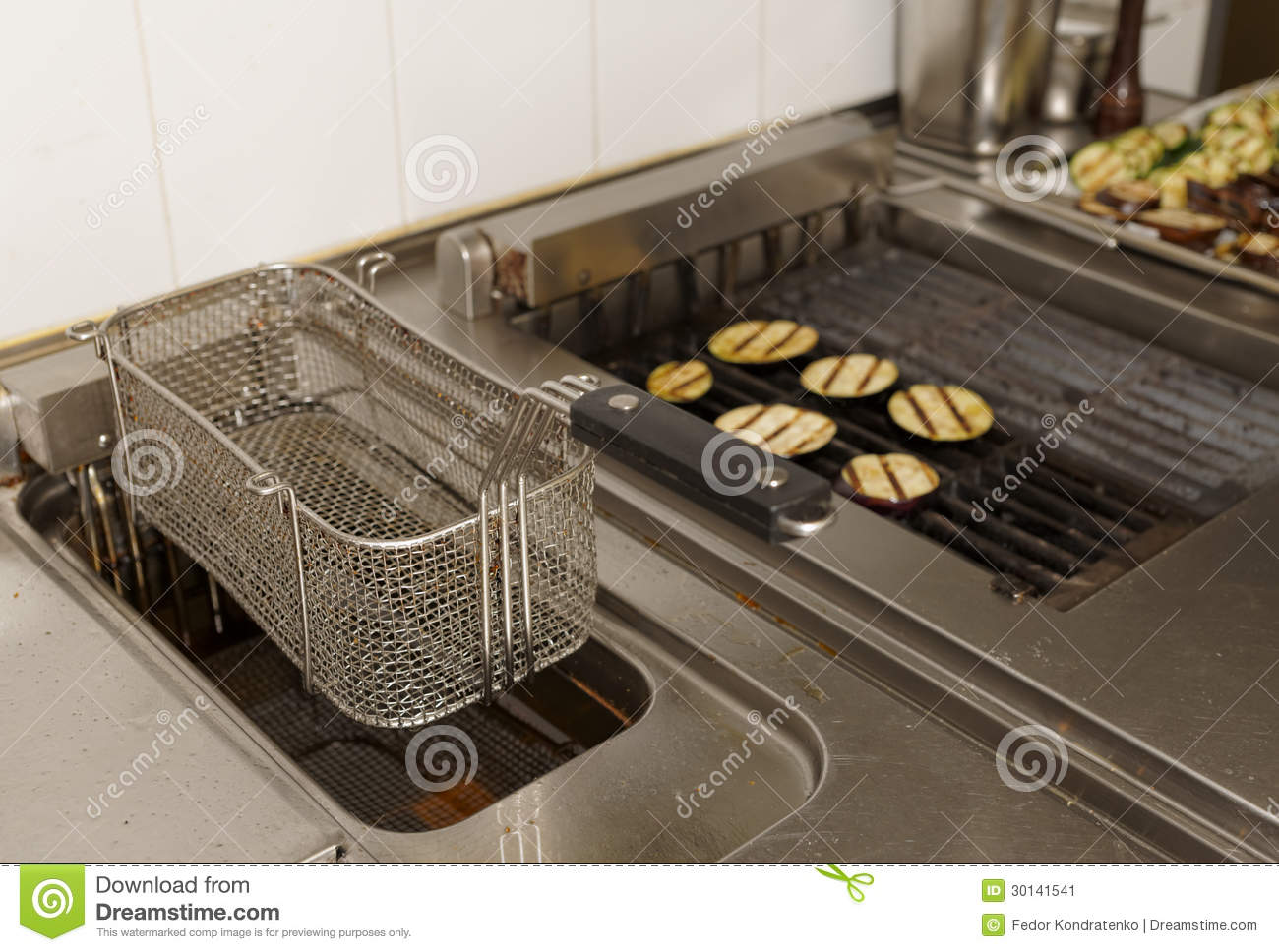 Restaurant Kitchen Grill deep fryer and grill on commercial kitchen stock image - image