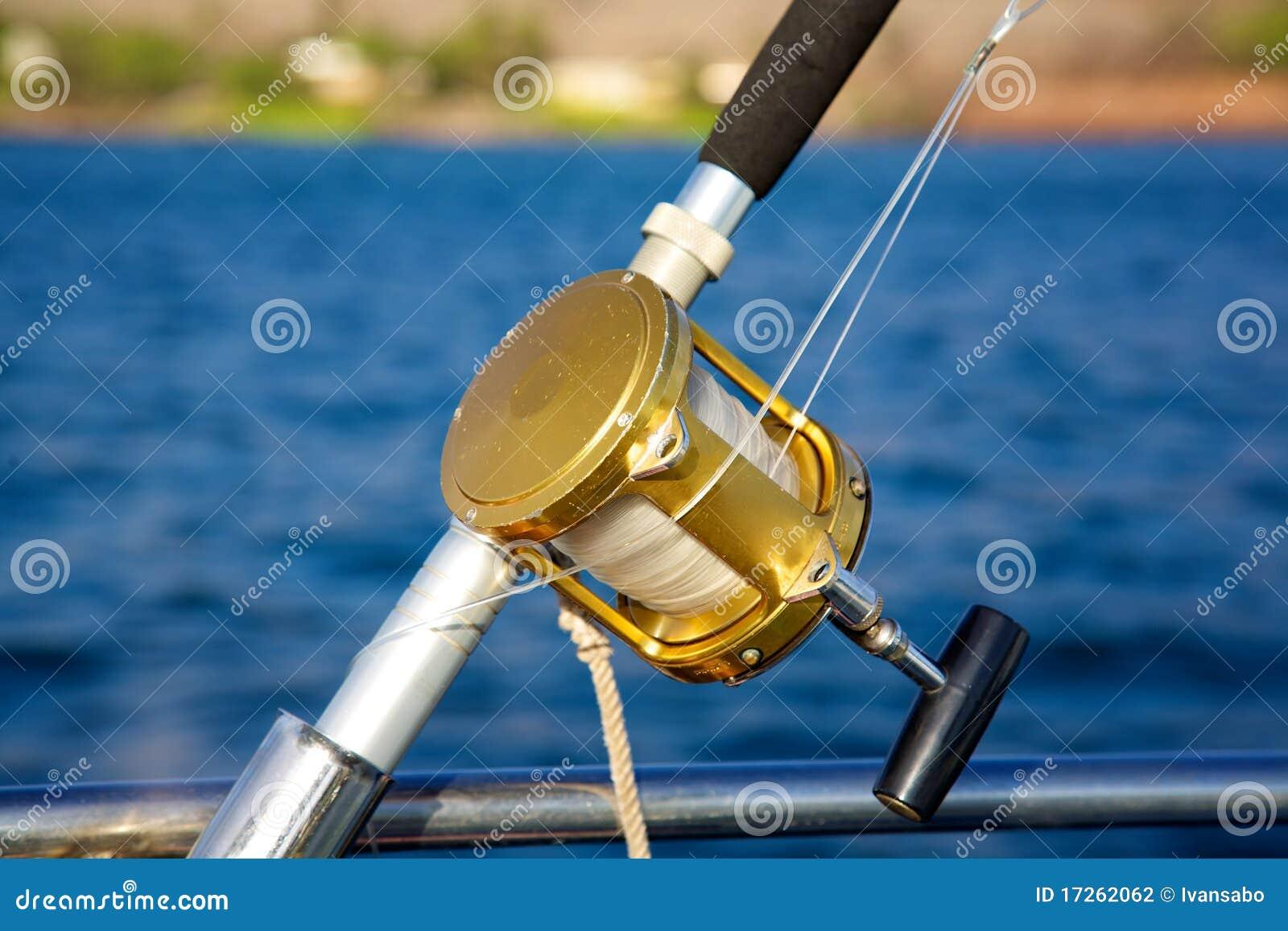 A deep sea fishing rod and reel stock photography image for Deep sea fishing rod and reel