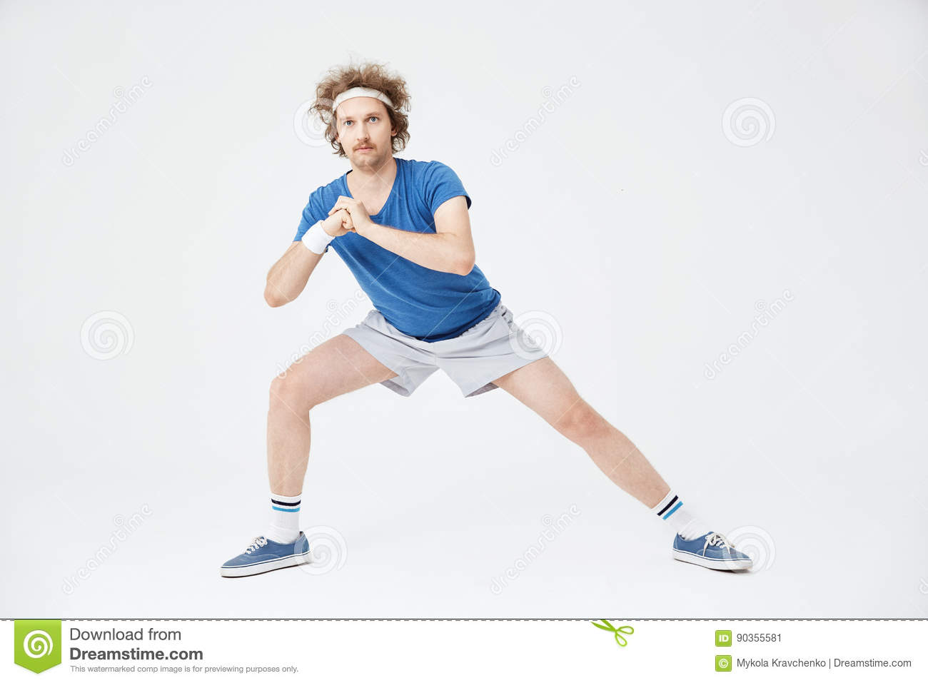 Deep Side Lunge Position Retro Man In Old Style Clothes Stock Image