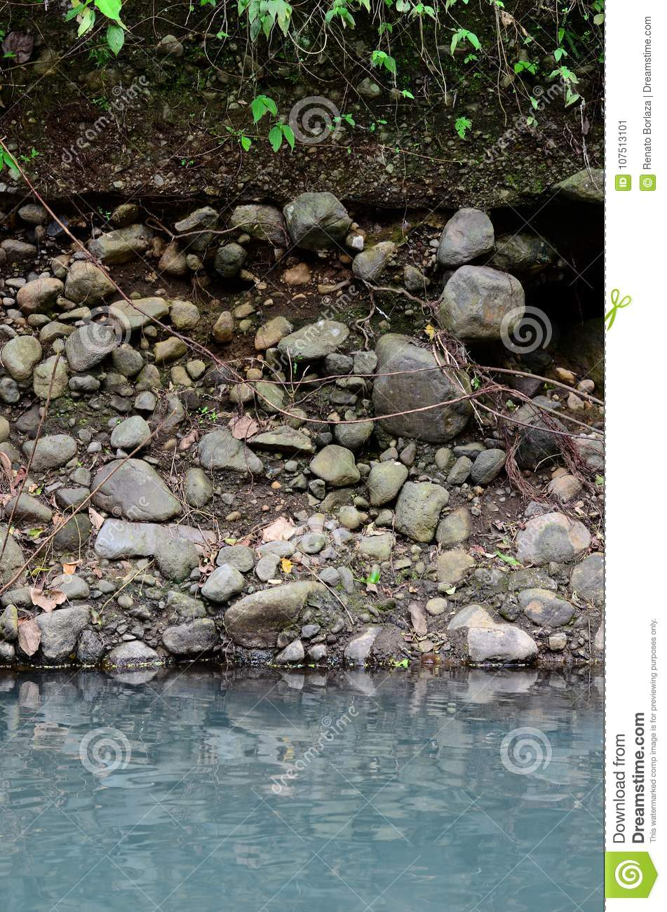 Deeply eroded river bank due to previous flooding