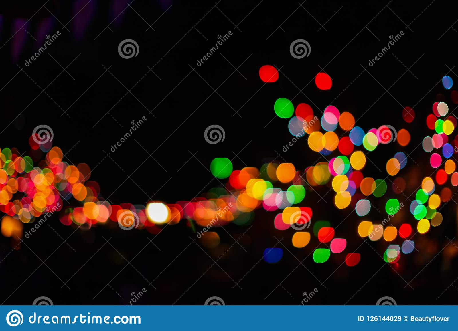 download defocus the christmas city at night colorful colored garland on the trees abstract
