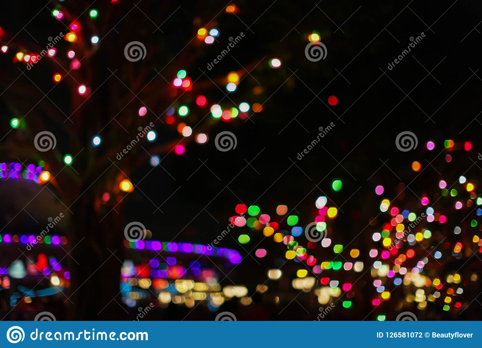 defocus the christmas city at night colorful colored garland on the trees abstract blurred backdrop
