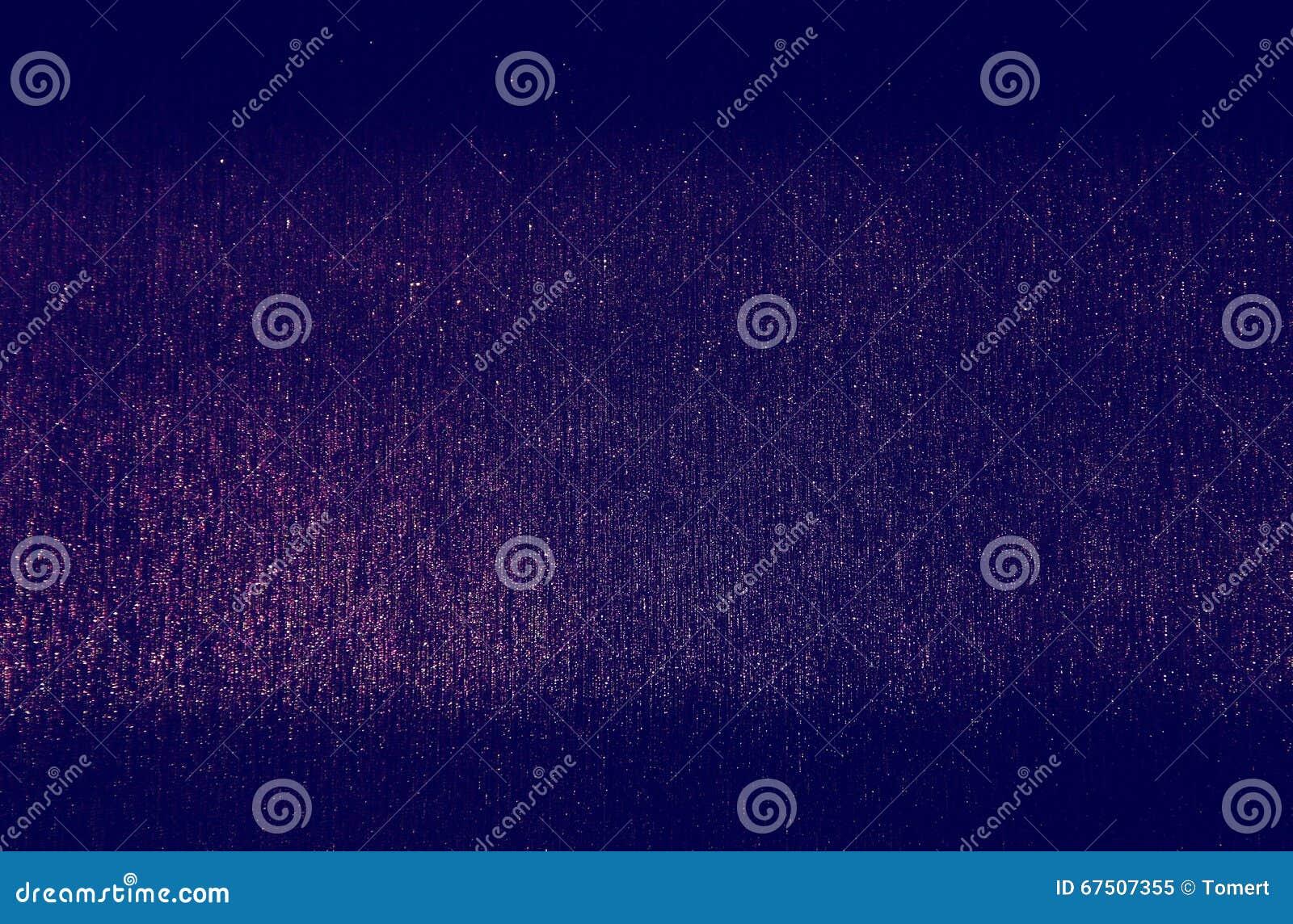 Defocused紫色和桃红色光背景照片