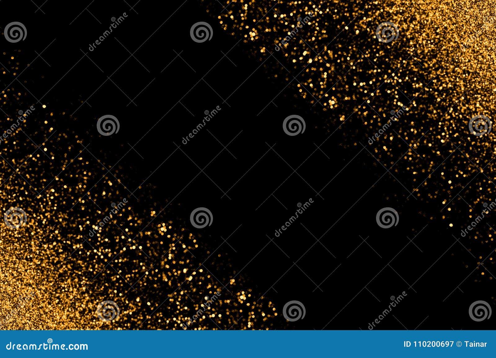 Defocused Goldfunkeln mit dem Glühen funkt Lichter auf einem schwarzen Hintergrund Explosion von Farben und von Formen