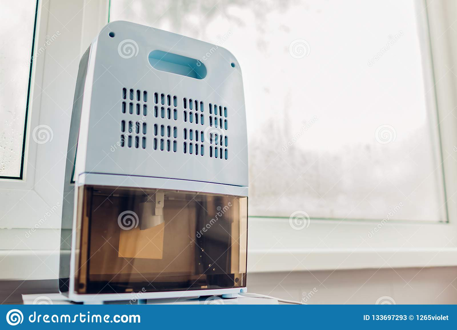 Dehumidifier with touch panel, humidity indicator, uv lamp, air ionizer, water container works by wet window