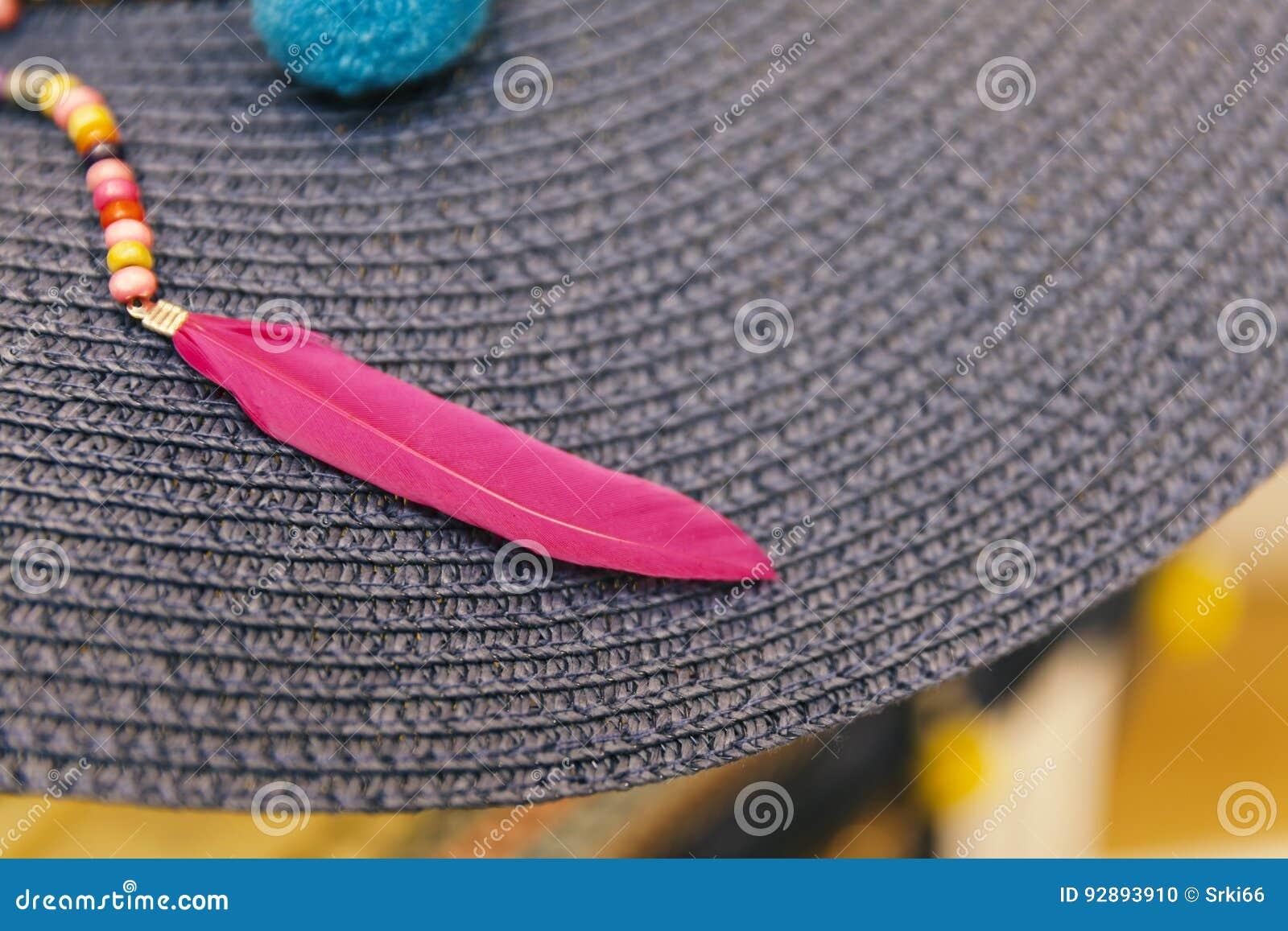 fjädrar i hatten