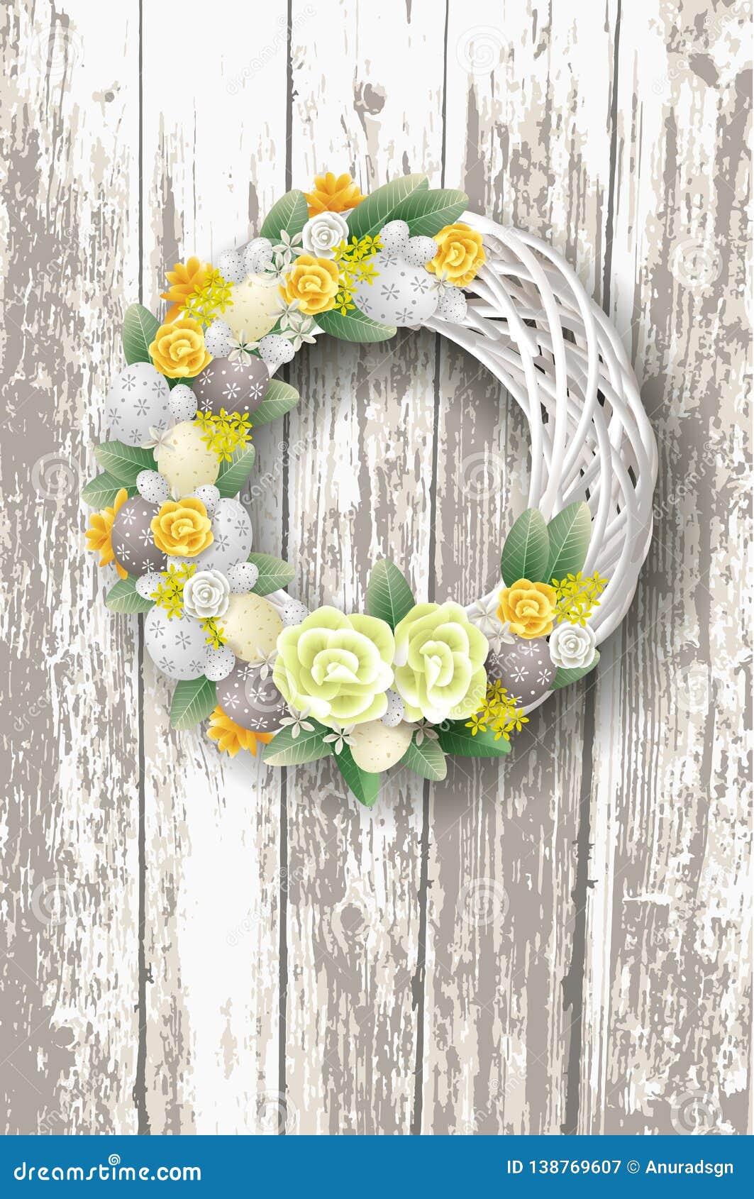 Dekorujący elegancki Wielkanocny wianek z jajko liśćmi na nieociosanym drewnianym tle i kwiatami -