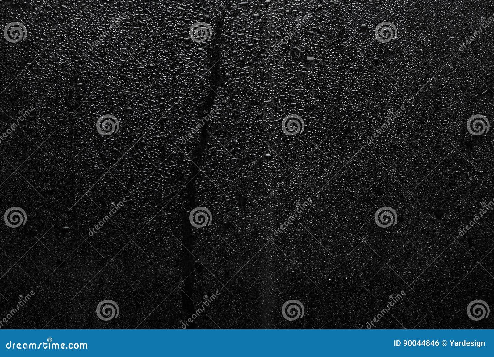 Del av serie Bakgrundsfotoet av regn tappar på mörkt exponeringsglas, olikt format: liten medel och stort