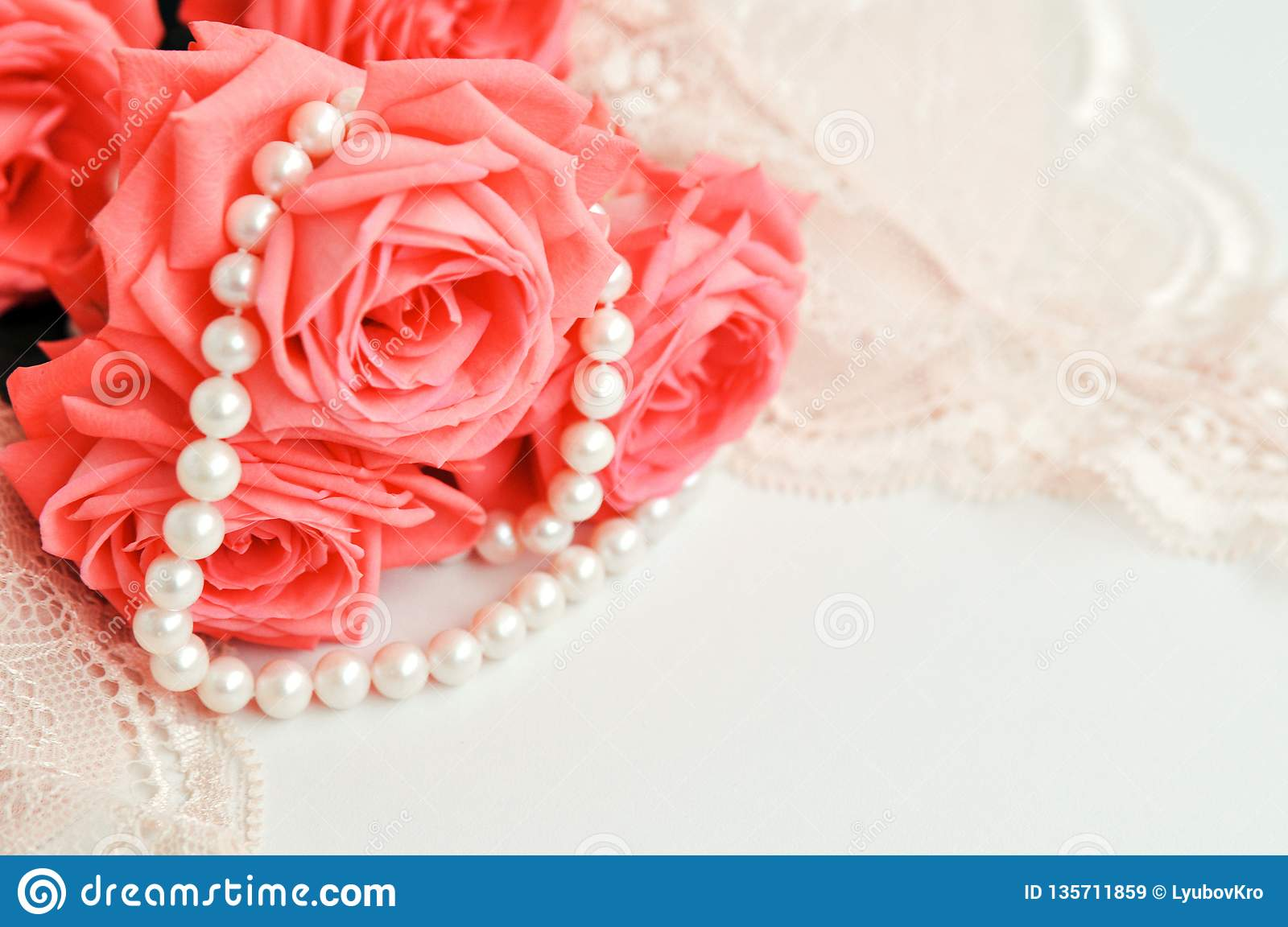 6b1e54bee5 ... roses trend color on a pale pink bra and pearl necklace on a white  background. top view. close up. Stylish lingerie flat lay. Underwear  fashion concept