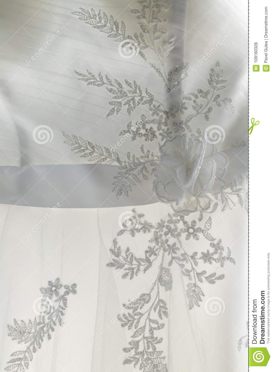 0ae4ca94ff7 Delicate lace fabric of white wedding dress of bride with embroidery in  floral shape transparent in daylight