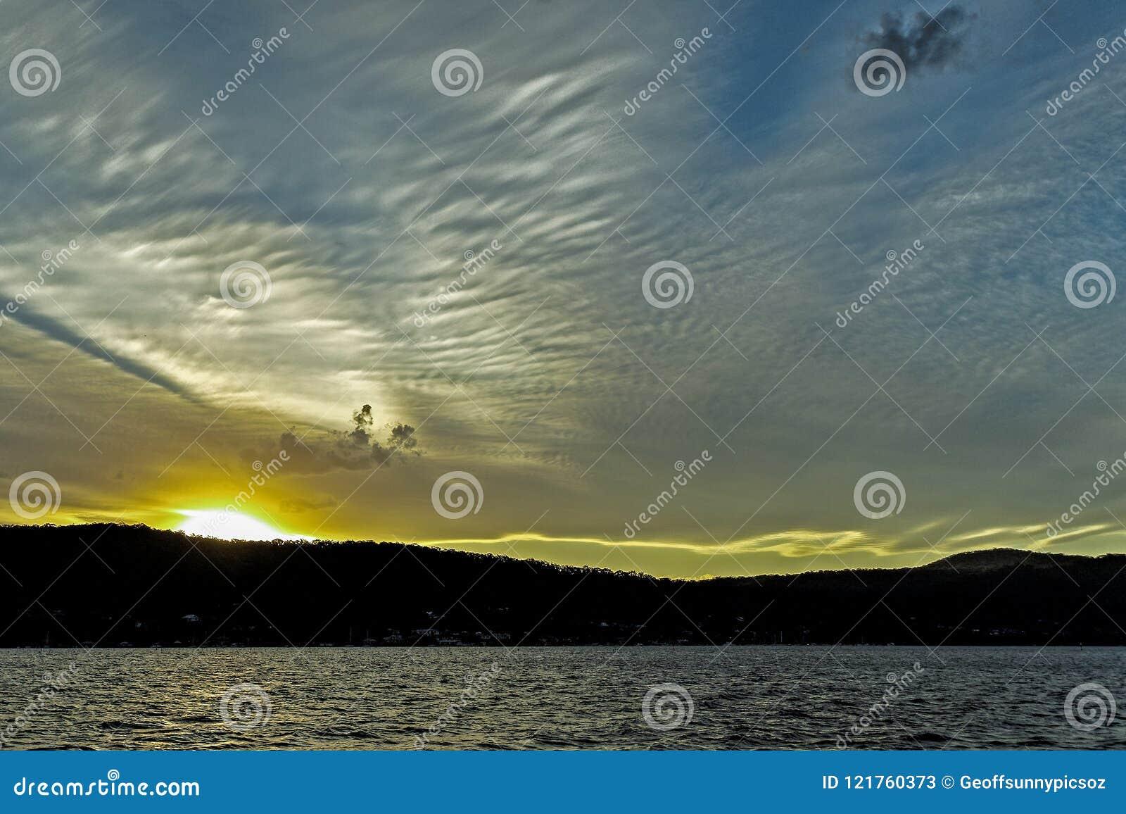 A delightful Cirrus cloud in pale blue sky. Australia.